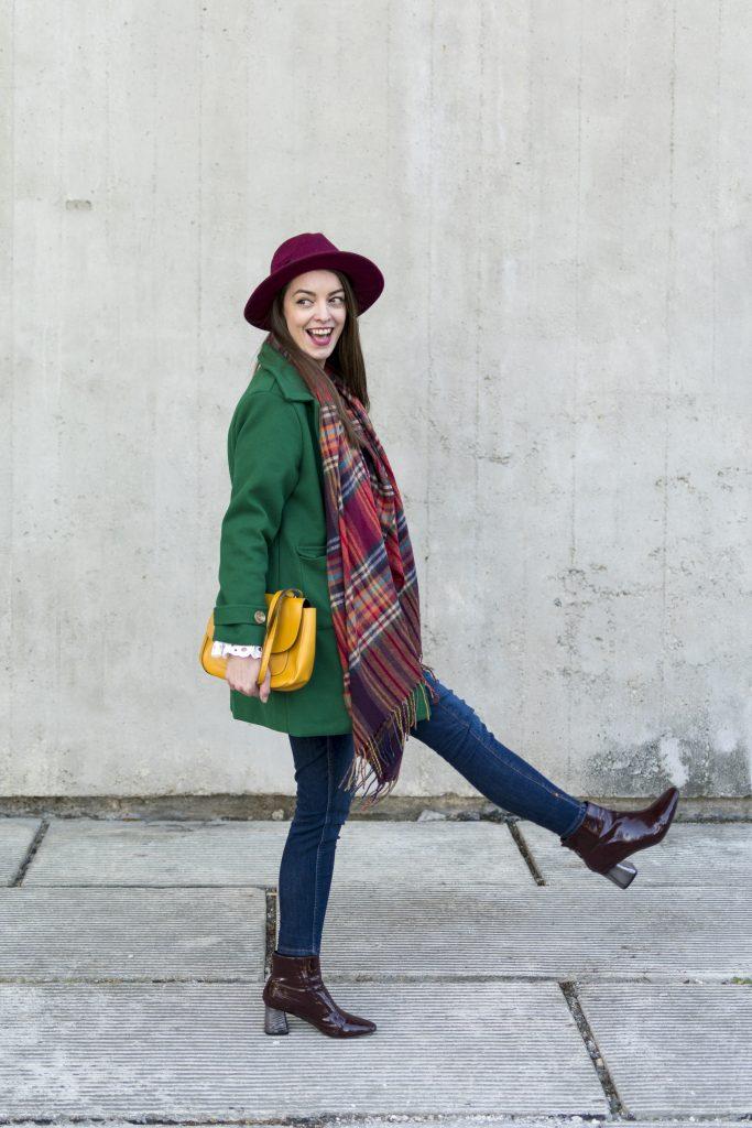 green coat yellow crosbody bag xmile girl burgundy hat and colorful scarf