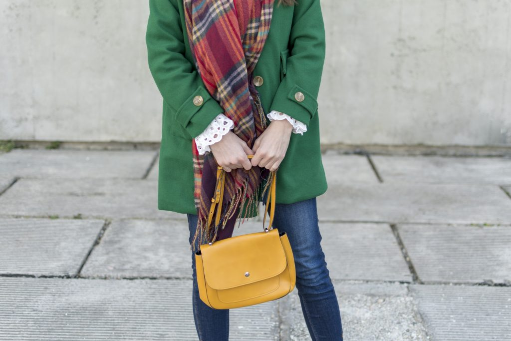 green coat yellow bag colorful outfit
